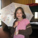 Ellie showcasing her umbrella -ella -ella craft